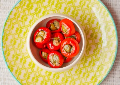 Chili peppers stuffed with anchovies and capers in olive oil